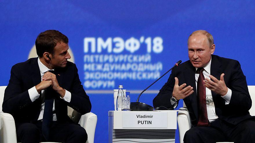 Macron e Putin, os conciliadores do Fórum Económico Mundial