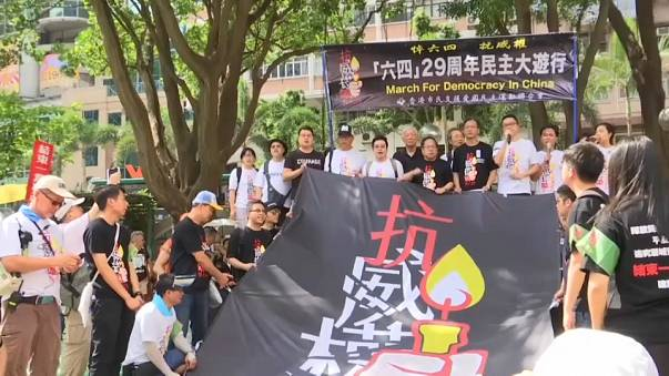 Hundreds of pro-democracy supporters march in Hong Kong