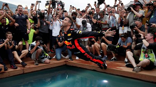 Red Bull's Daniel Ricciardo jumps into a pool