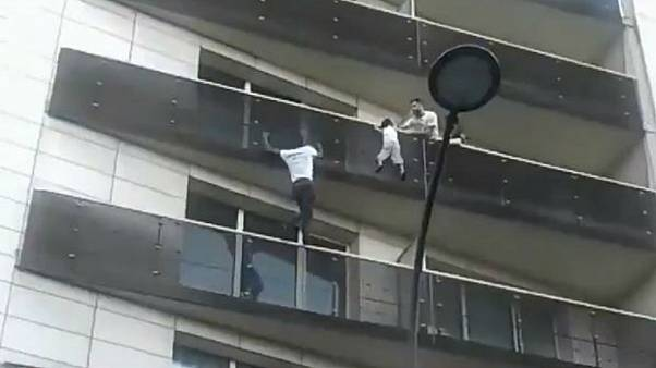 Immigrant who saved child from balcony fall given path to French citizenship