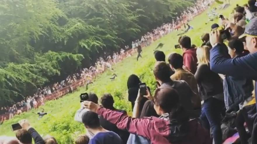 Watch: Competitors tumble down hill at annual UK cheese-rolling race
