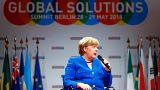 Angela Merkel a berlini Global Solutions Summiton kérdésekre válaszol