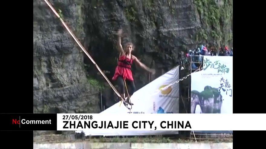 A woman walks a highwire in high-heels