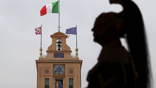 Italian military officer stands guard inside the Presidential Palace