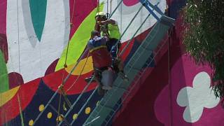 A rescuer reaches a stranded painter in Mexico City