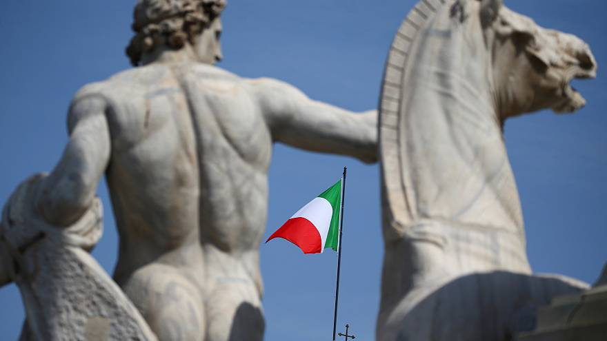 The Italian flag waves over the Quirinal Palace in Rome
