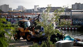 Police brought in bulldozers to help clear a migrant camp in Paris