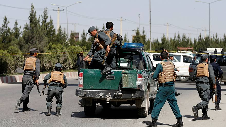Afghan police arrive at the scene of the attack