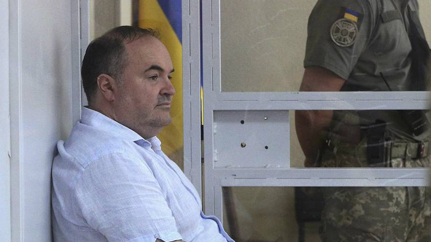 بوريس هيرمان أثناء التحقيق معه في المحكمة في كييف - المصدر: رويترز.