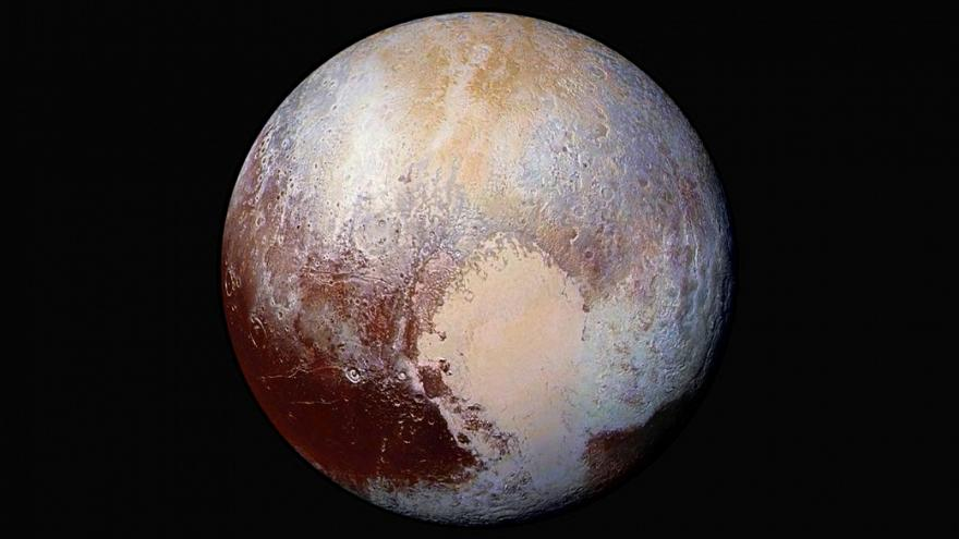 Is Pluto a giant comet? And does it really have dunes on its surface?