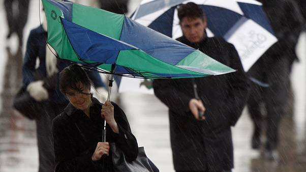 Torrential rain and thunderstorms cause 'travel chaos' in UK