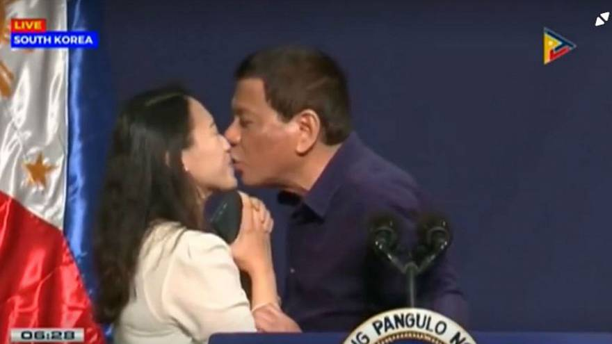 Duterte's kiss with Filipino woman sparks controversy