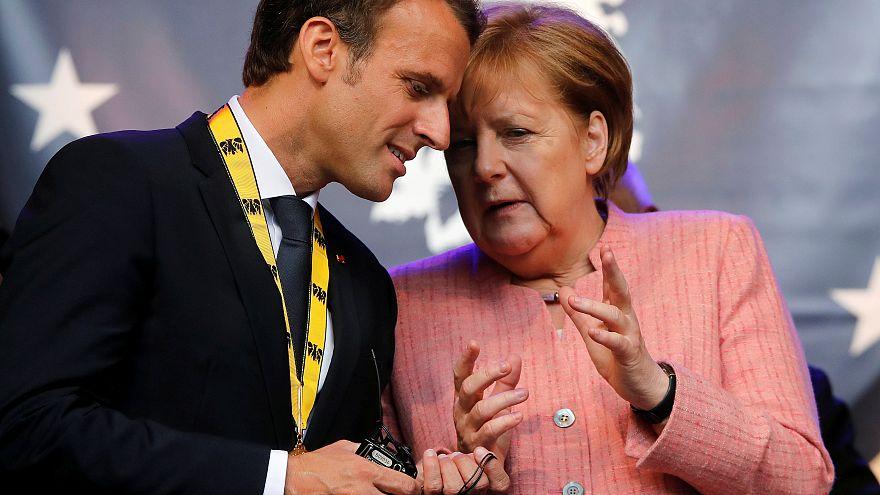 Merkel e l'euro, un passo verso Macron