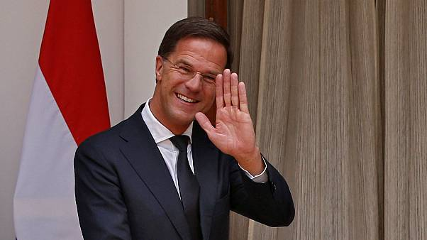 Watch: Dutch PM Rutte applauded after clearing up own coffee spill