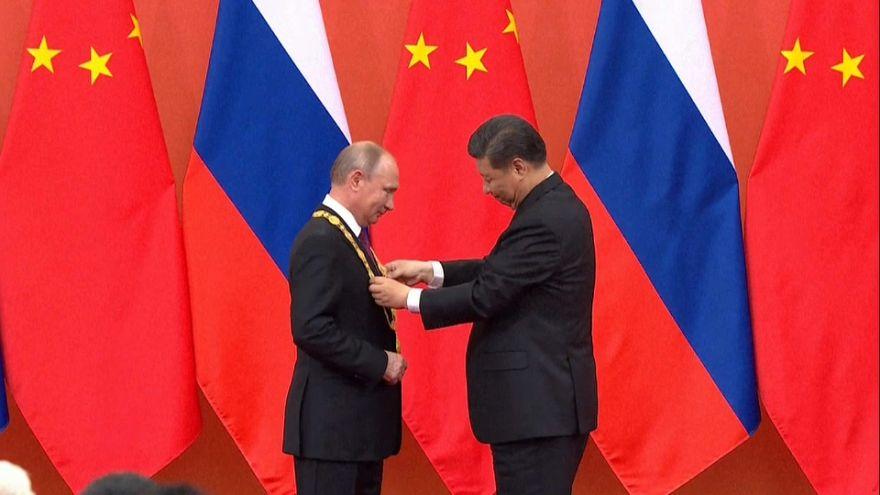 As G7 summit begins Russia's Putin meet China's Xi