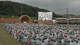 Japan's Emperor and Empress plant trees at Fukushima