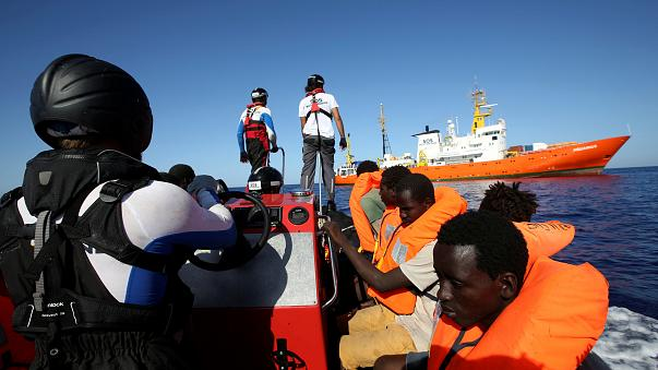 Migrants on a rubber boat are rescued by the SOS Mediterranee