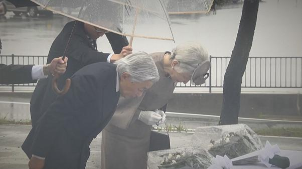 Japan'`s Emperor Akihito and Empress Michiko pay respects to tsunami victims