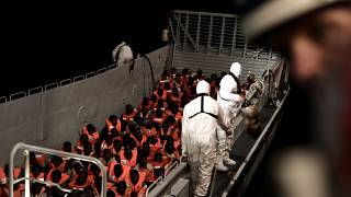 Rescued migrants to be transferred from overloaded ship for voyage to Spain