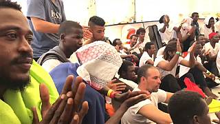 Applause broke out when the migrants learned of Spain's offer.