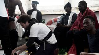 A staff member checks the physical condition of a migrant on Aquarius