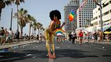 Revellers take part in a gay pride parade in Tel Aviv, Israel June 8, 2018.