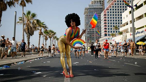 Revellers take part in a gay pride parade in Tel Aviv, Israel June 8, 2018.