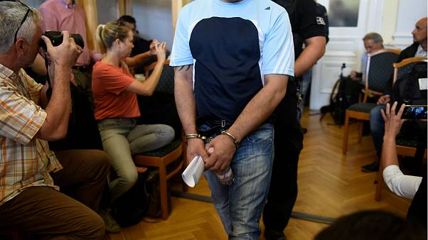 Four men, charged with the killing of 71 migrants