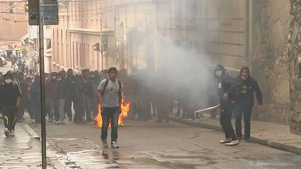 Tear gas, rockets fly as Bolivian students clash with police