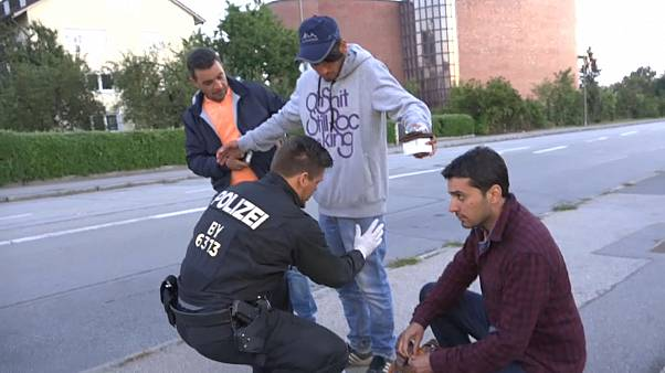 A migrant is searched by police