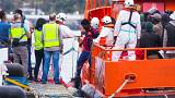 Migrants arrive aboard a Spanish maritime rescue boat