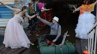 Locals throw 'Venetian Carnival' in flooded underpass in Novosibirsk