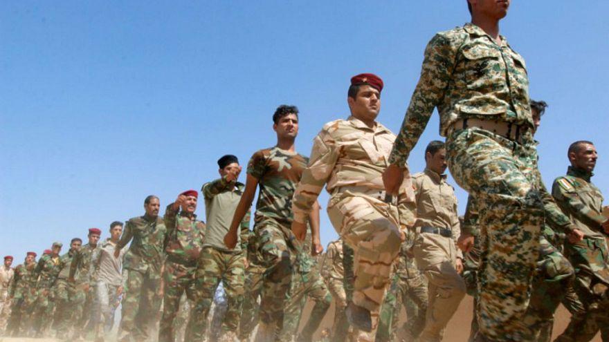 قوات الحشد الشعبي خلال استعراض عسكري بالقرب من كركوك بالعراق