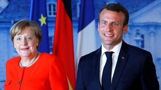 German Chancellor Angela Merkel welcomes French President Emmanuel Macron