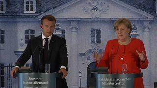Flüchtlinge: Merkel und Macron wollen europäische Lösung