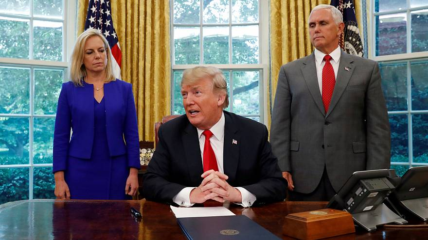 Trump signs executive order to keep immigrant families together