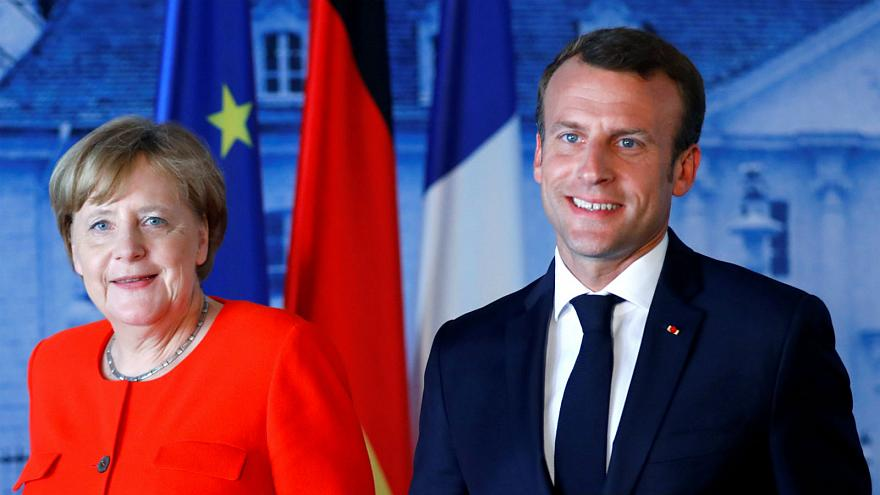 Image result for Merkel and Macron
