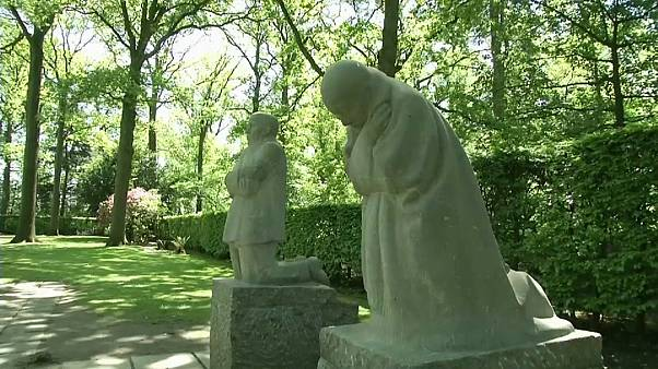 Statues of grieving parents at Vladslo cemetary in Belgium