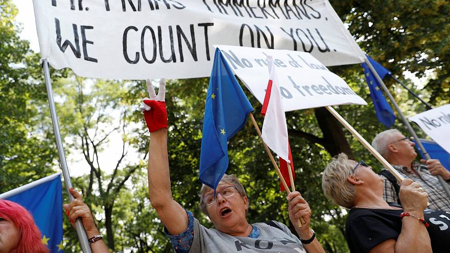 Demonstrators rally during meeting of Polish PM and  EC's Frans Timmermans