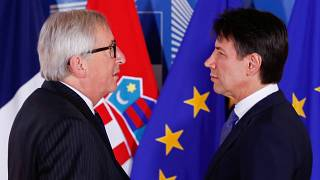 Italian Prime Minister Giuseppe Conte is welcomed by European Commission Pr