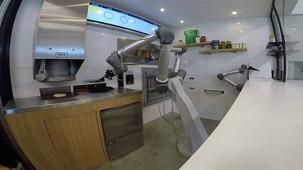 A robot making a pizza