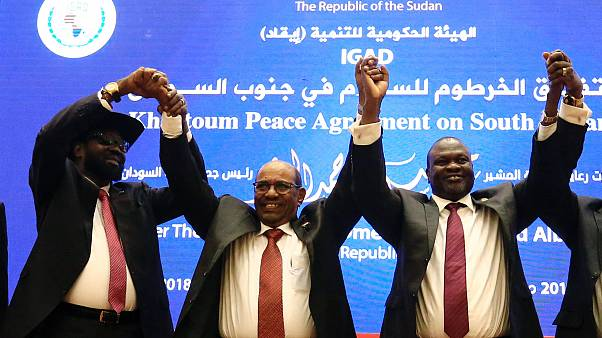South Sudan's rival leaders after signing a peace deal