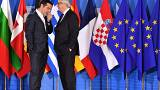 European Commission President Jean-Claude Juncker speaks with Greek Prime M