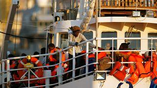 Rescued migrants disembarking in Europe