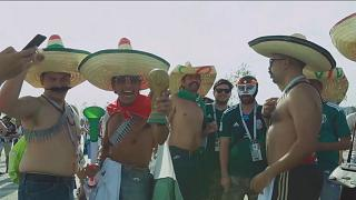 World Cup fans don fancy outfits to show support for their teams