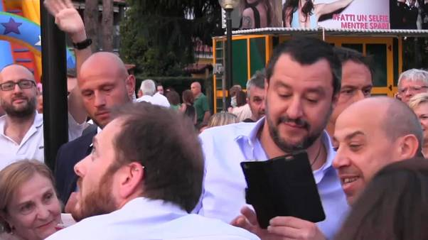 Italy's interior minister Matteo Salvini poses for a selfie