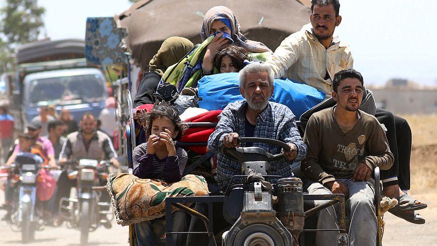Civilians seeking safety near Daraa in southern Syria
