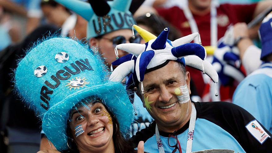 Uruguay joins the final eight after beating Portugal 2-1