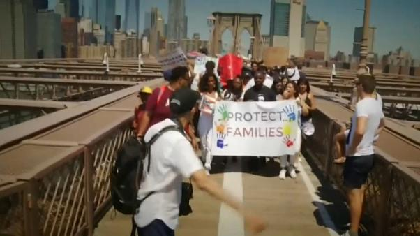 """US protestors: """"Immigrants Are Welcome Here!"""""""
