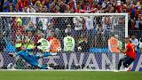 Last 16: Russia's Igor Akinfeev saves a penalty from Spain's Iago Aspas